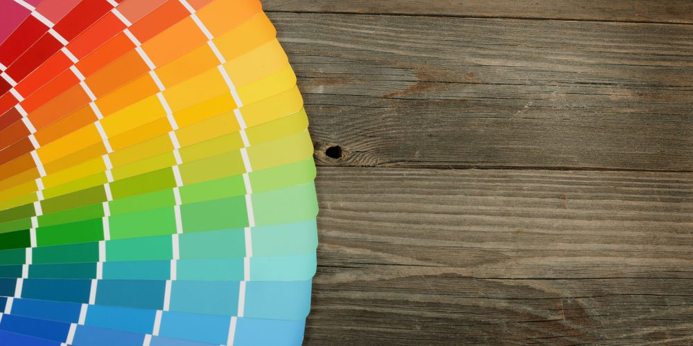 The color palette on the wooden background